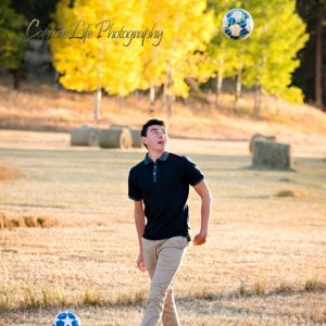 Trey Mossman Senior Portrait - Soccer Balls